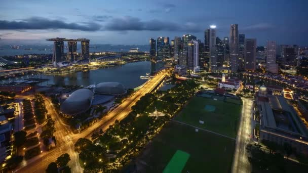 Sunrise night to day 4k time lapse at Marina Bay Singapore. Zoom out