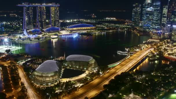 Time lapse of night scene at Marina Bay Singapore. Pan left