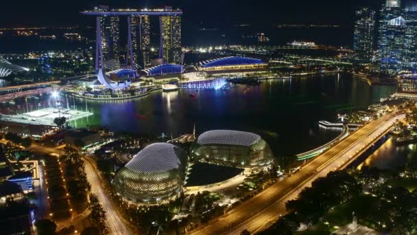 Time lapse of night scene at Marina Bay Singapore. Pan right