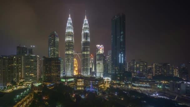 4k time lapse of sunset scene at Kuala Lumpur city skyline. Tilt down