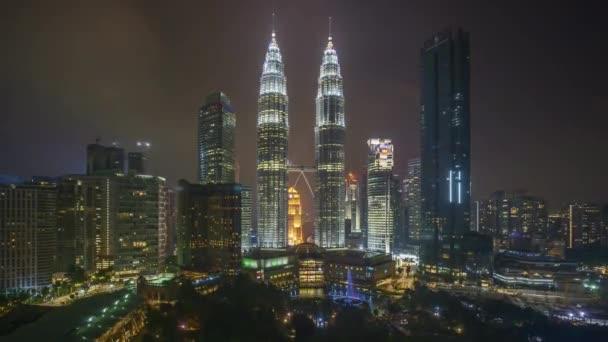 4k time lapse of sunset scene at Kuala Lumpur city skyline. Zoom out