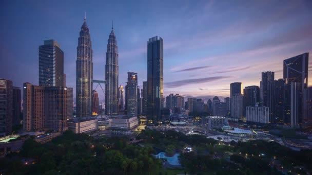 4k time lapse of sunrise scene at Kuala Lumpur city skyline.