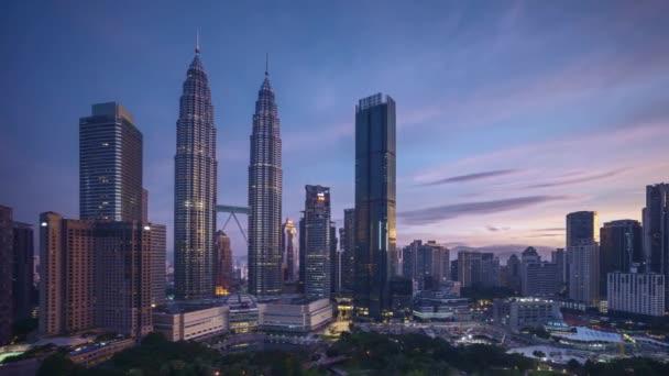 4k time lapse of sunrise scene at Kuala Lumpur city skyline. Pan right