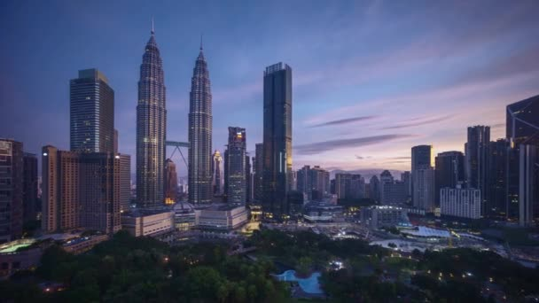 4k time lapse of sunrise scene at Kuala Lumpur city skyline. Zoom in