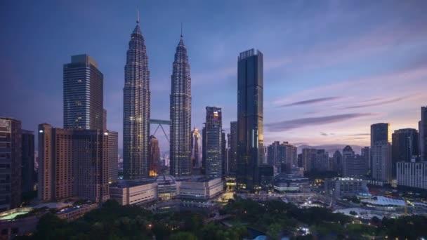4k time lapse of sunrise scene at Kuala Lumpur city skyline. Zoom out