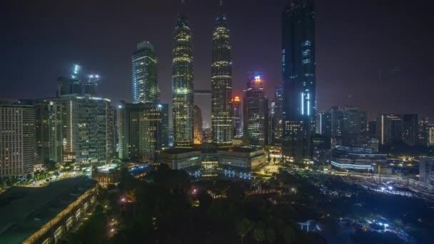 4k time lapse of sunrise scene at Kuala Lumpur city skyline. Tilt up