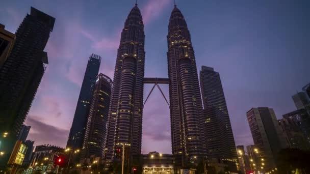 4k time lapse of sunrise scene at Kuala Lumpur city skyline. Tilt down