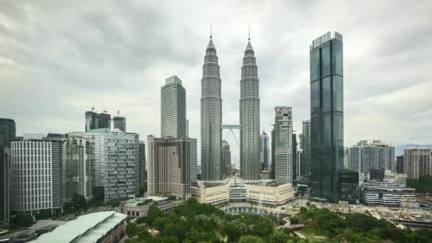 4k time lapse of sunset scene at Kuala Lumpur city skyline. Pan right