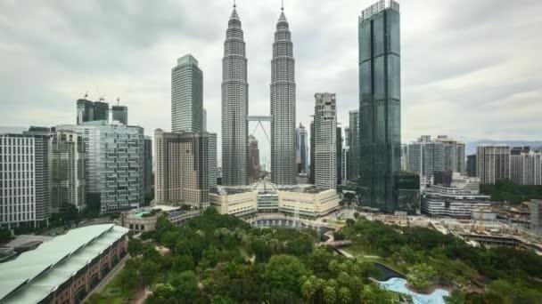 4k time lapse of sunset scene at Kuala Lumpur city skyline. Tilt up