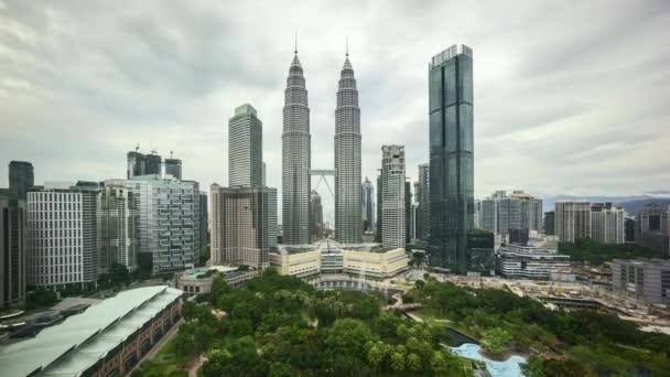 4k time lapse of sunset scene at Kuala Lumpur city skyline. Zoom in