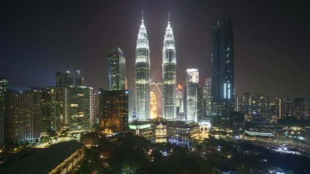 4k time lapse of night scene at Kuala Lumpur city skyline. Pan right