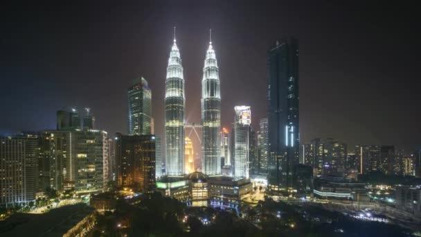 4k time lapse of night scene at Kuala Lumpur city skyline. Tilt down