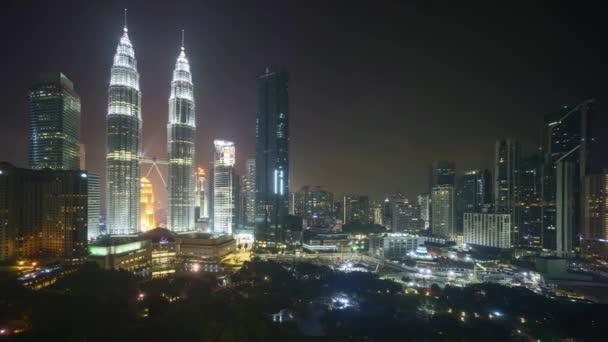 4k time lapse of night scene at Kuala Lumpur city skyline. Pan left