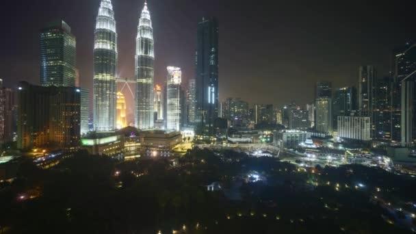 4k time lapse of night scene at Kuala Lumpur city skyline. Tilt up