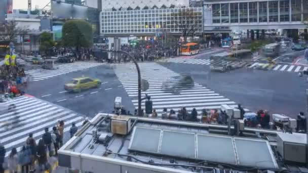 Shibuya Crossing, Tokyo, one of the busiest road intersection in the world (scramble crosswalk). Time lapse day to night sunset scene. Pan left