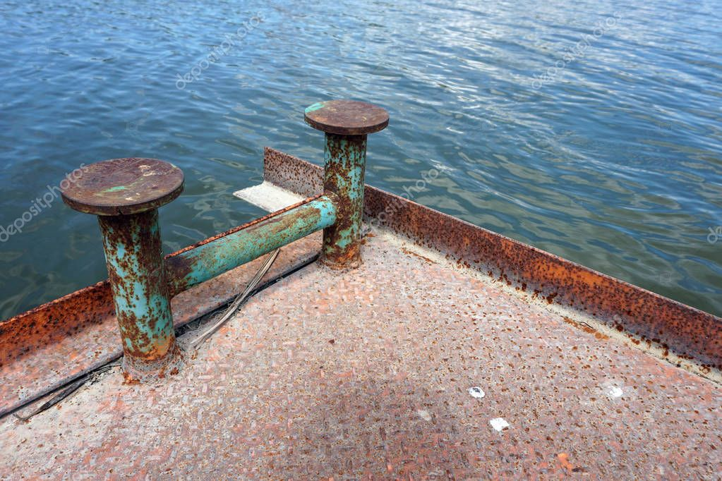 Marina bollard (bitt) at jetty for boats, ships and yachts mooring (knecht cross)