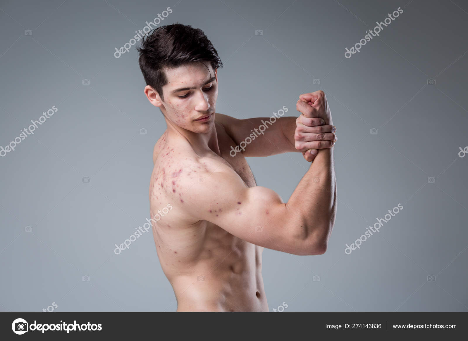 Studio portrait young Caucasian man on gray background posing  theme