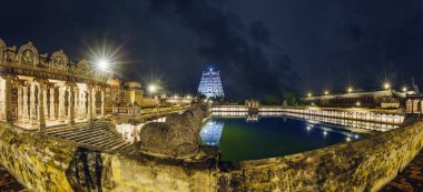 An ancient temple of India and lake night. Situated in Chidambaram, Tamilnadu. It's very famous temple of lord Shiva. Lots of people around the world come to visit this temple each year.