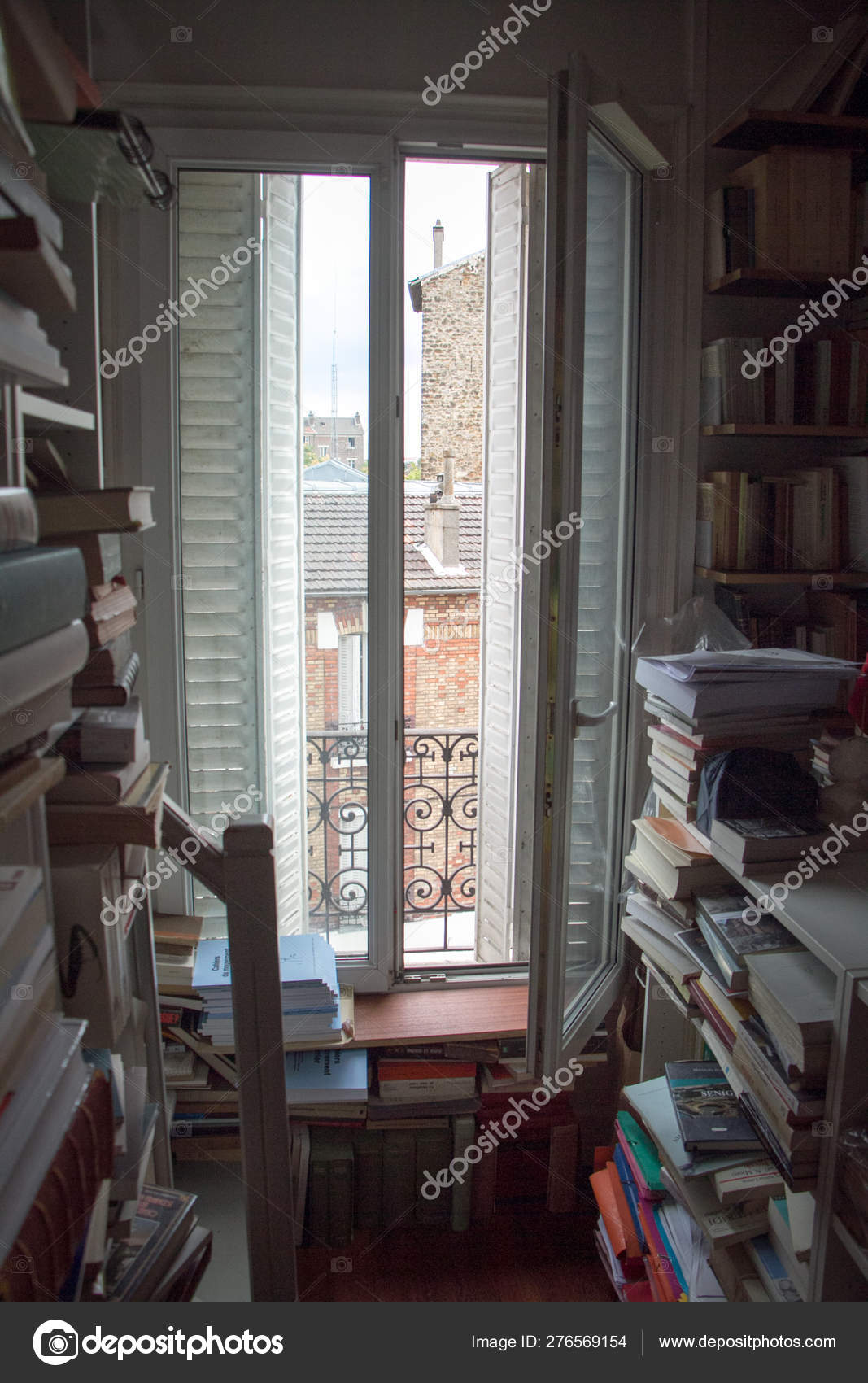 Home Library With A Huge Number Of Books And A Window With