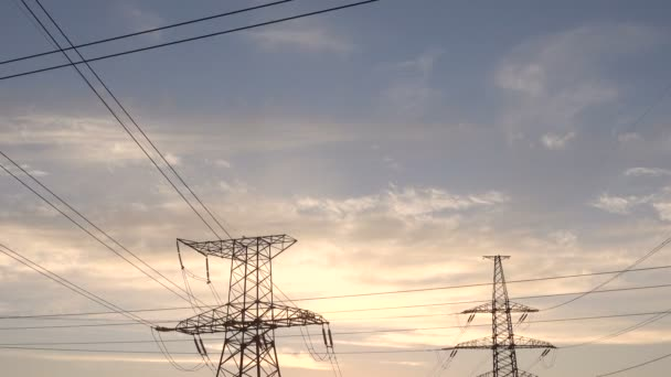 High Voltage Power Line at Sunset. Poles with wires