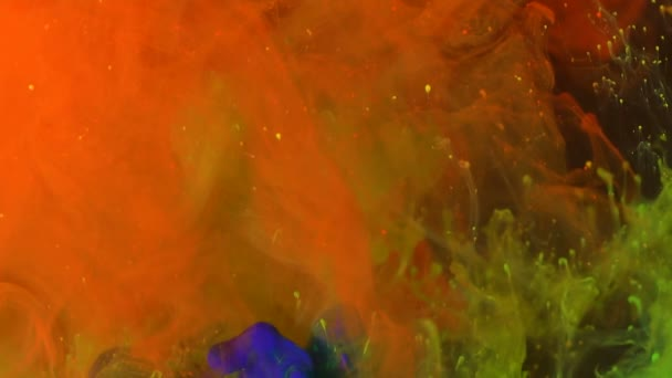 Colorful paint in water. Slow Motion