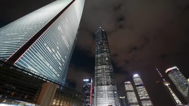 cloud flying shanghai huanqiu skyscraper  pearl-tower at night.