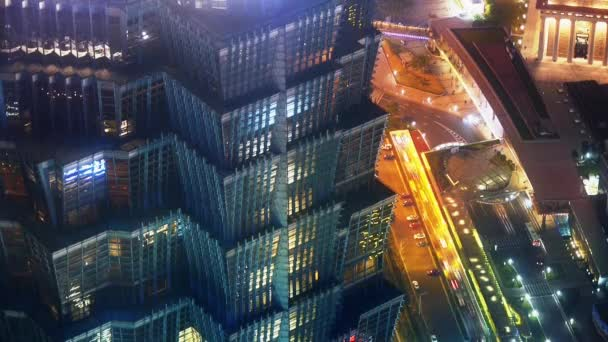 Elevated view of high-rise buildings rooftop crown at night in Shanghai,China.busy urban traffic,time lapse.