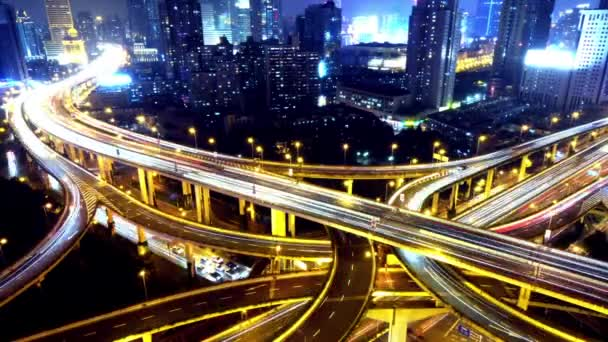 Time lapse busy urban traffic with streaking lights trail at night,shanghai.