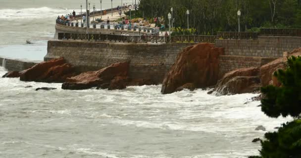 4k waves washed dam,People on shore.ocean sea watercoastal rock surge coast.