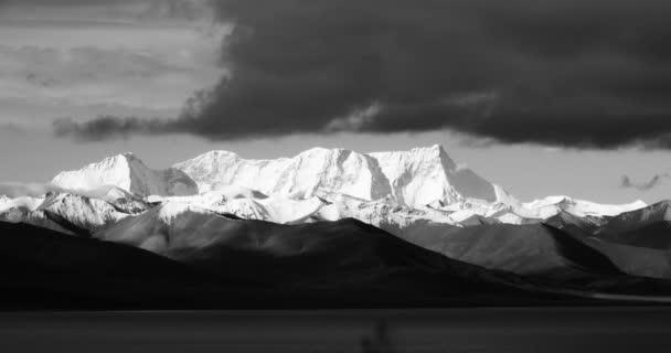 4k huge clouds mass rolling over lake namtso  snow mountain,tibet mansarovar.