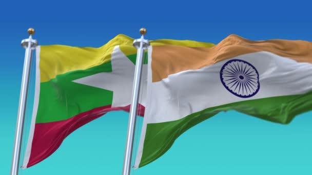 4k bezešvé Indie a Myanmar vlajky s modrým nebem pozadí, JP, IND.