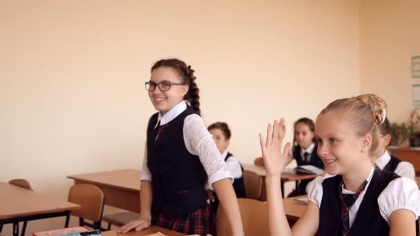 girl in school uniform in class rises that would answer