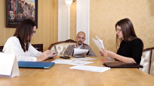 Angry boss scolding female employee for bad work result sitting at conference table, male director yelling at incompetent subordinate blaming for mistake in financial document at diverse team meeting