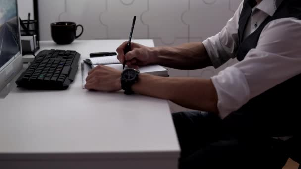 Detective fills out his diary, removes it in table and leaves the office.