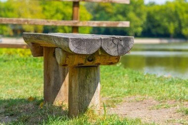 Wooden bench close to the lake shore