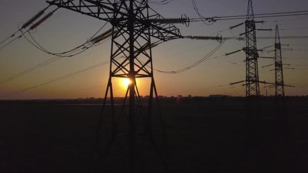 Sunset and High-voltage power pylon