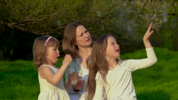 Mom with three daughters rest in the park
