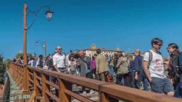 Pedestrians walk over the Academy Bridge in Venice