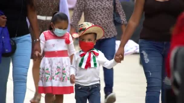 MEXICO CITY, SEPT 2020. Two children wearing face masks walk on the Madero street after authorities relaxed the restrictions about COVID 19, people try to return to their activities.