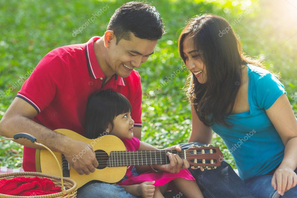 Happy musical family singing together, outdoor portrait