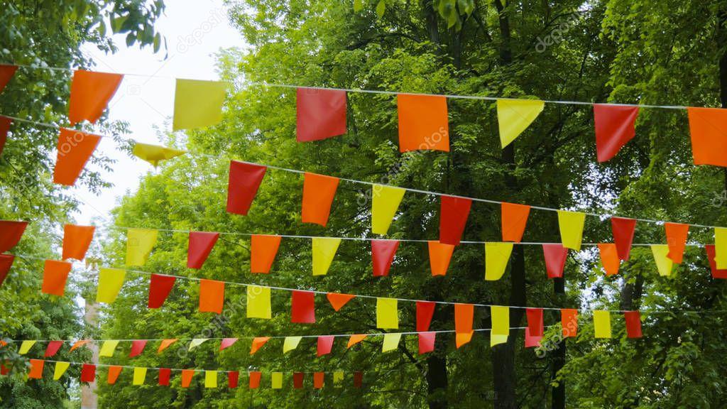 Decorative garlands of colorful rectangular flags