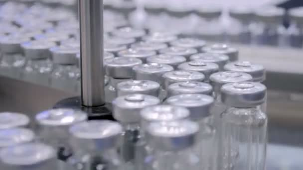 Automated pharma technology concept - conveyor belt with empty glass bottles