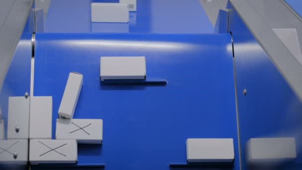 Top view - moving white small cardboard boxes on conveyor belt