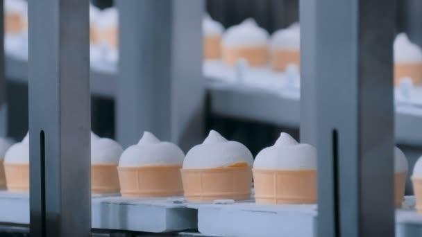 Ice cream automatic production line - conveyor belt with icecream cones