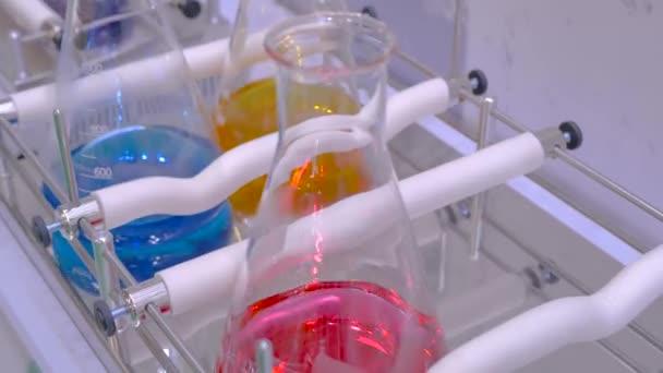 Orbital shaker for mixing, shaking, blending biological samples in glass vials