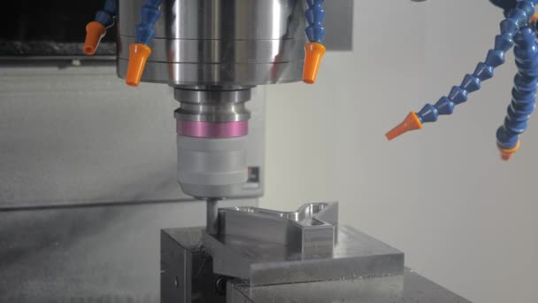 Close up - automated turning milling machine cutting metal workpiece at factory