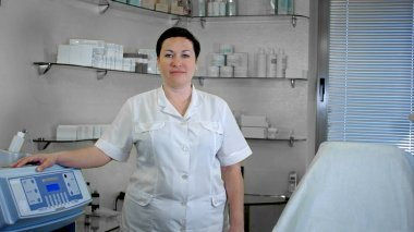 Portrait of confident female doctor standing in lab coat, looking at camera