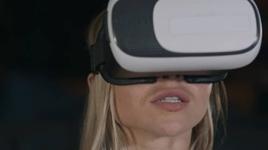 Young woman with vr glasses watching movie