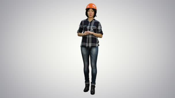 Asian engineer with helmet talk to a camera on white background