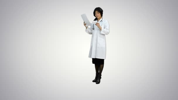 Friendly asian doctor woman working with documents and new pills on white background
